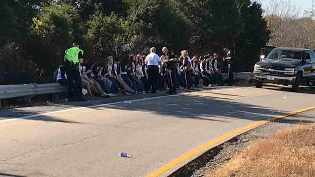 School bus crash injures 20 students