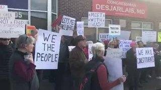 Dozens Protest Outside Rep. DesJarlais' Office