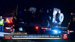 Woman Detained After Jeep, Train Collide