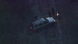 Body Found In SUV On Train Tracks