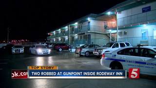 Armed Suspect Robs 2 At Gunpoint In Motel Room