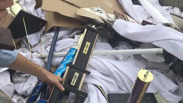 Marching Band Trophies Thrown Into Dumpster
