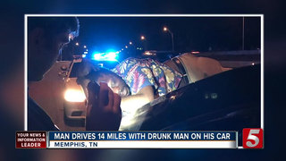 Drunk man rides 14 miles on couple's trunk