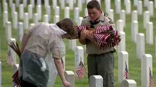 Boy Scouts Place Flags At Veterans' Graves