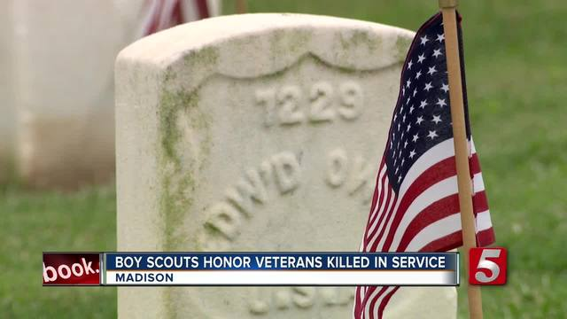 Boy Scouts Place Flags At Veterans- Graves