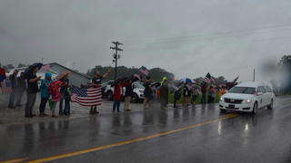 People Line Streets To Honor Fallen Soldier