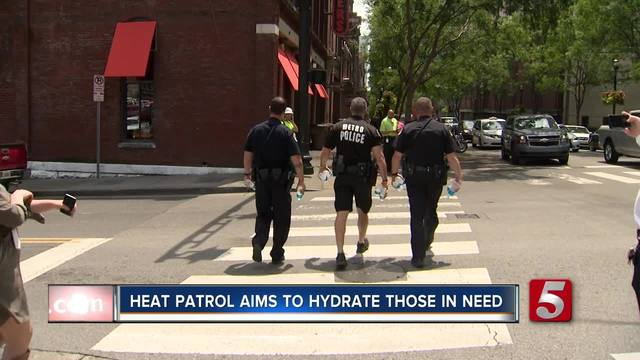 Metro Police Out On Heat Patrol- Distribute Water Bottles