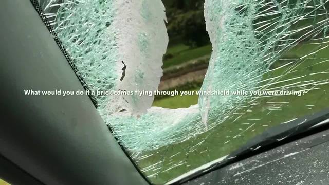Brick Thrown Through Windshield Hurts Driver