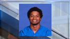 Football coach charged with soliciting teen