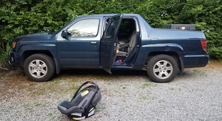 Child dies after being left in car seat