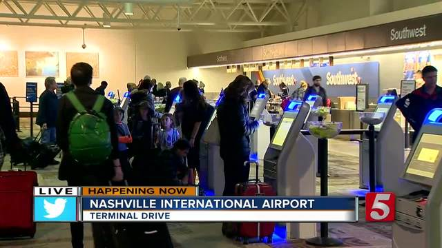 Waves of Thanksgiving holiday travelers hit area highways and airports