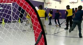 Students Play In Street Hockey Clinic