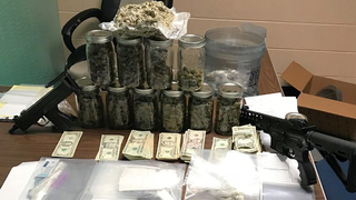 Heroin, Weapons Seized; 21-Year-Old Arrested